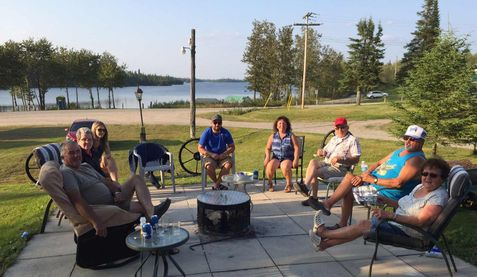 Group of friends relaxing at Remi Lake